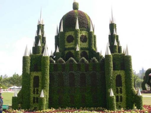 вот такие сады в китае (Фигурно постриженые кусты, деревья и не только)